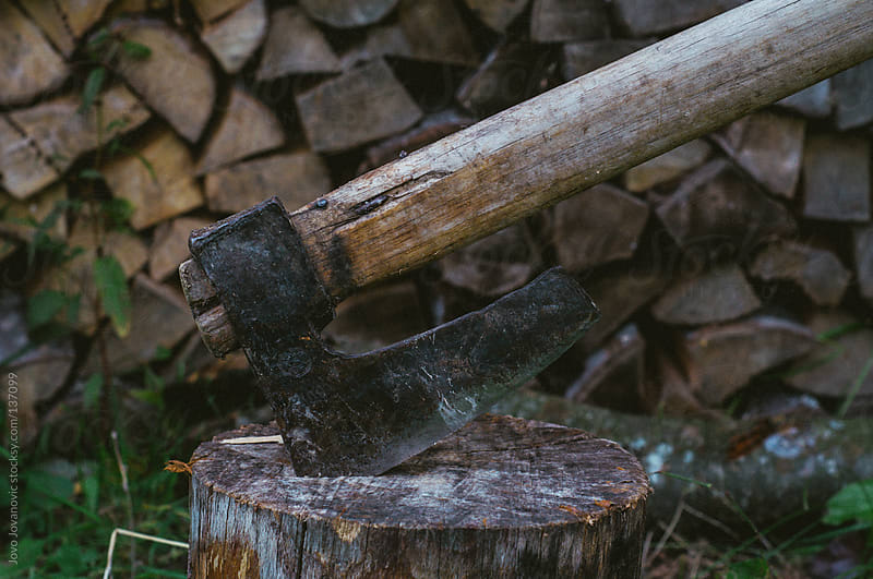 Axe used for firewood.  by Jovo Jovanovic for Stocksy United