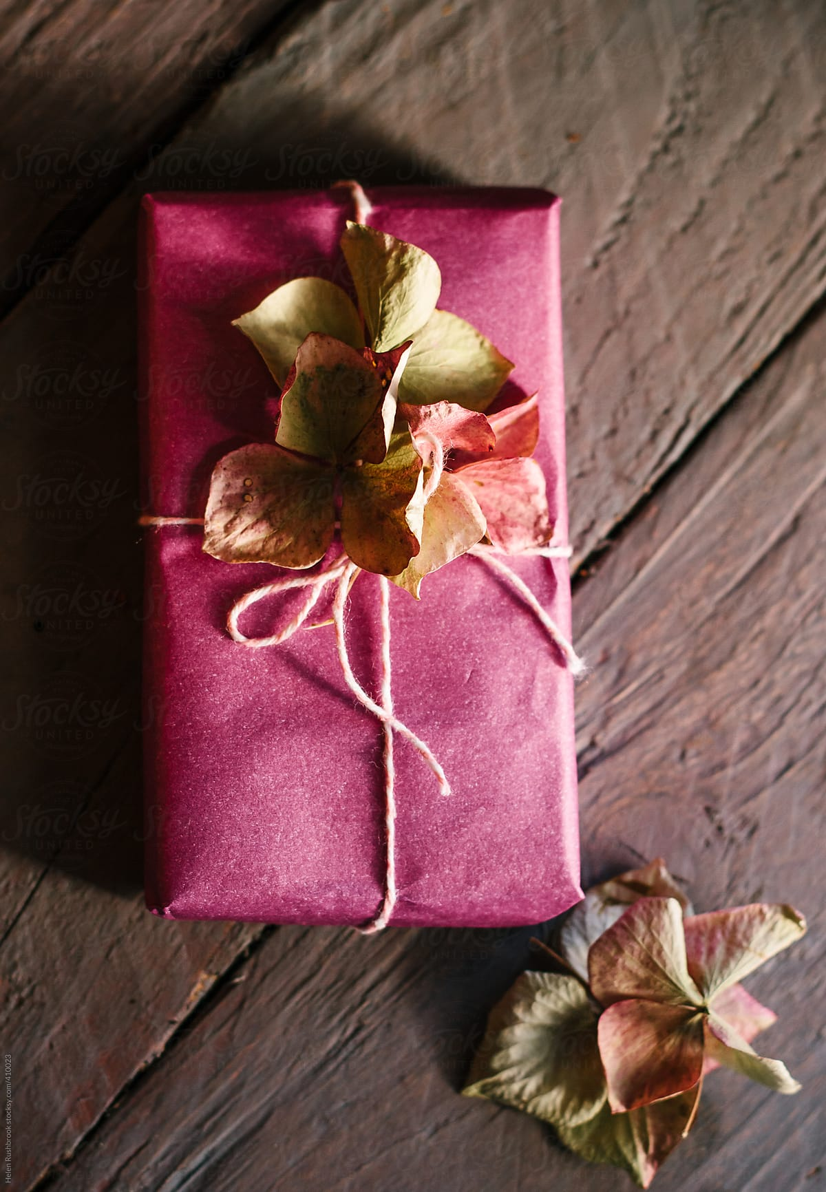 A small gift wrapped in pink paper and decorated with dried flowers a small gift wrapped in pink paper and decorated with dried flowers by helen mightylinksfo