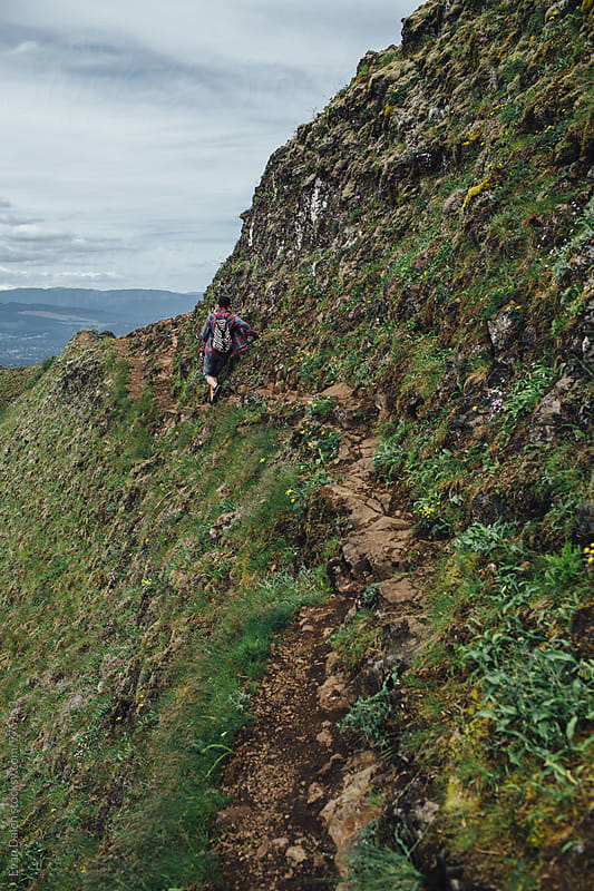 Woman Hiker Climbing Narrow Path on Cliff by Evan Dalen for Stocksy United