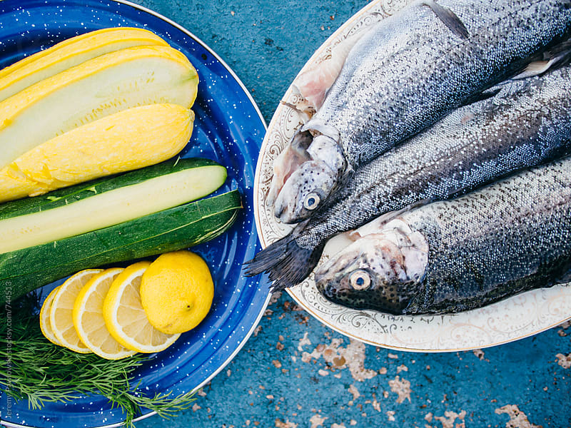 Fish, vegetables, lemon and dill on plate by Jeremy Pawlowski for Stocksy United