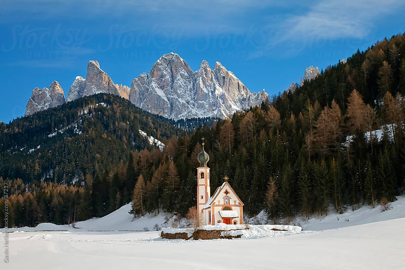 Winter landscape of St Johann Church in Ranui in Villnoss,, Geisler Spitzen (3060m), Val di Funes, Dolomites mountains, Trentino-Alto Adige, South Tirol (Tyrol), Italy, Europe by Gavin Hellier for Stocksy United