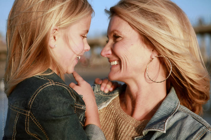 Happy Mother and Daughter Smiling at Eachother