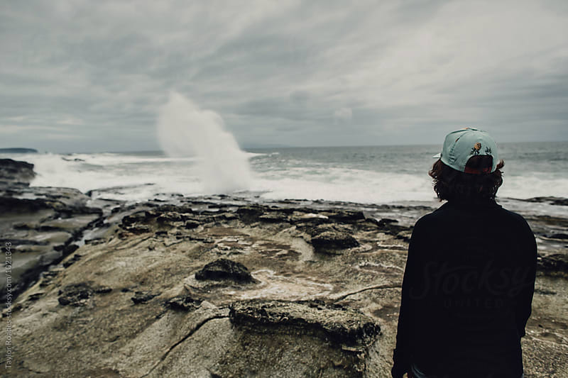 Ocean Surge Channel with Hiker by Taylor Roades for Stocksy United