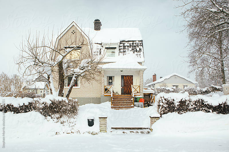 Typical Rural House in Winter by Stephen Morris for Stocksy United
