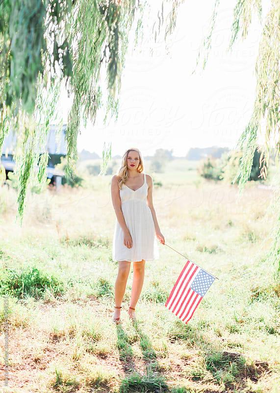 Teen girl with American Flag by Marta Locklear for Stocksy United