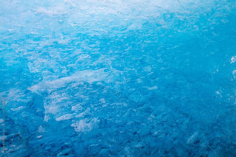 Blue ice detail of an iceberg by Mihael Blikshteyn for Stocksy United