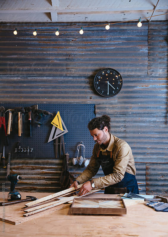 Man working on his art in his workshop studo by Trinette Reed for Stocksy United