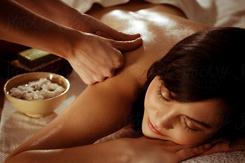 Woman enjoying massage in spa center. by Mosuno for Stocksy United