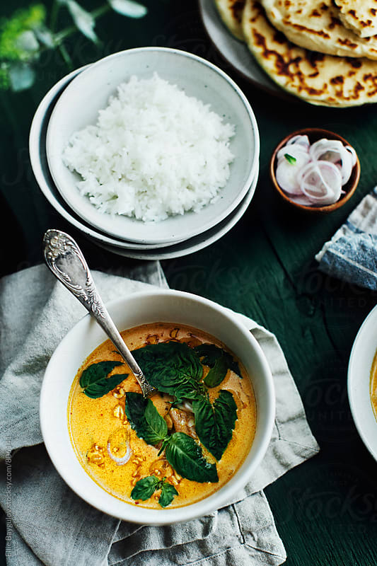 Thai chicken curry by Ellie Baygulov for Stocksy United