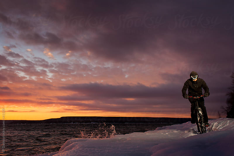 Extreme Winter Sport Man Riding Fat Bike In Snow at Dawn by JP Danko for Stocksy United