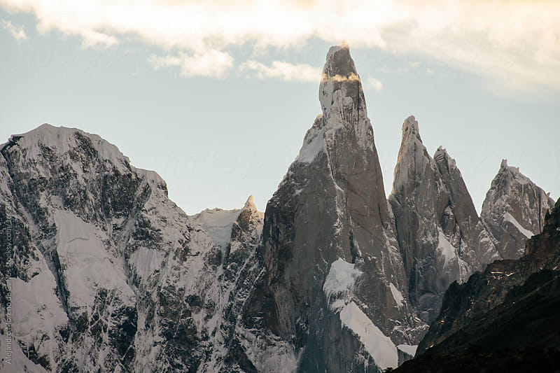 Mountains with snow at sunset, Cerro Torre, Patagonia by Alejandro Moreno de Carlos for Stocksy United