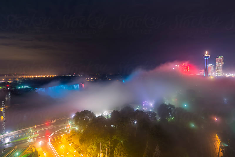 Fog over Niagara Falls at Night, Canada / United States by Tom Uhlenberg for Stocksy United