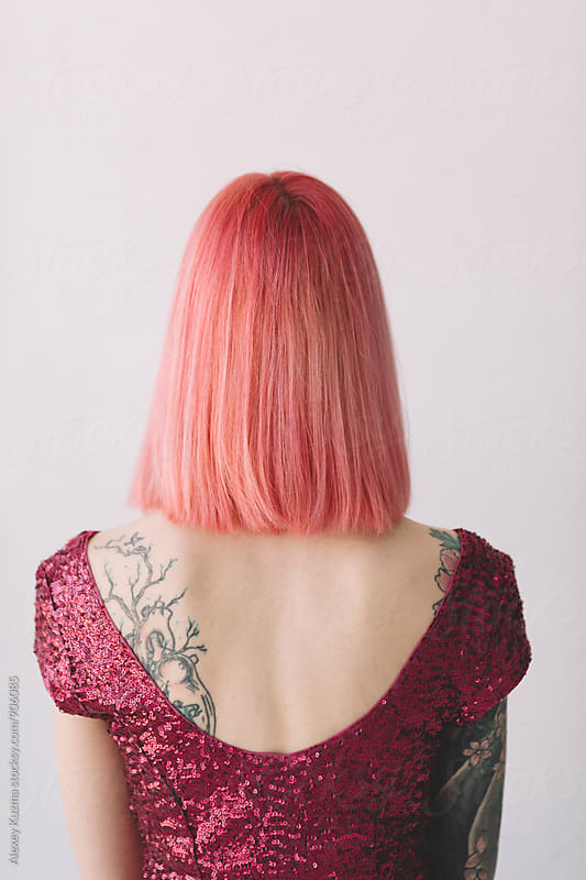 portrait of young woman with pink hair by Vesna for Stocksy United