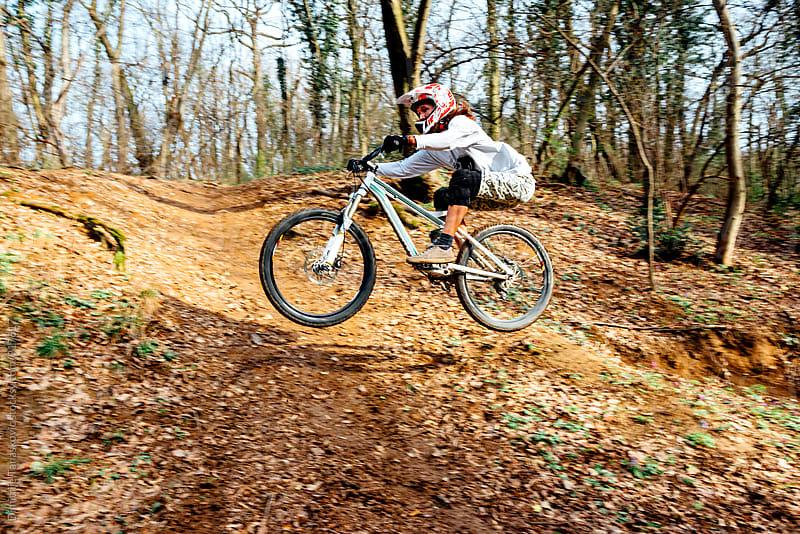 Man riding mountain bike by Dimitrije Tanaskovic for Stocksy United