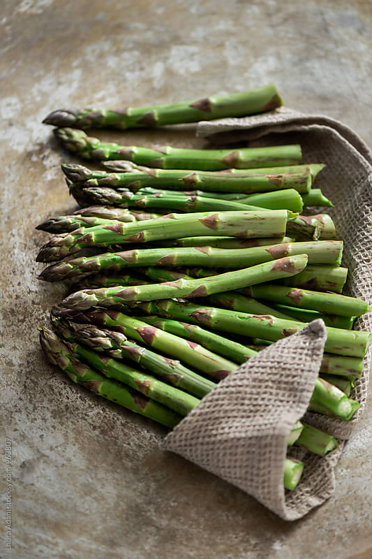 Fresh asparagus ready to be cooked by Laura Adani for Stocksy United
