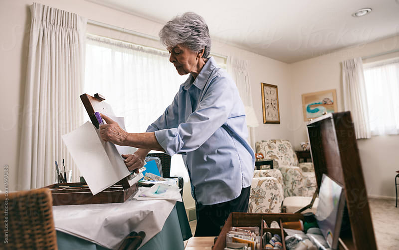 Senior: Woman Using Paper Towel To Texture Canvas by Sean Locke for Stocksy United
