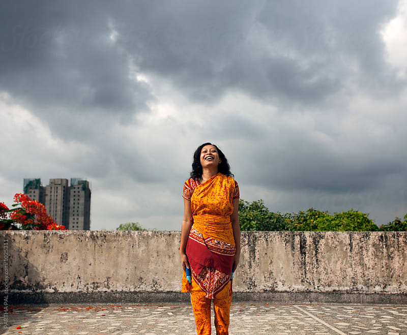 Young woman laughing and standing in outdoor by PARTHA PAL for Stocksy United