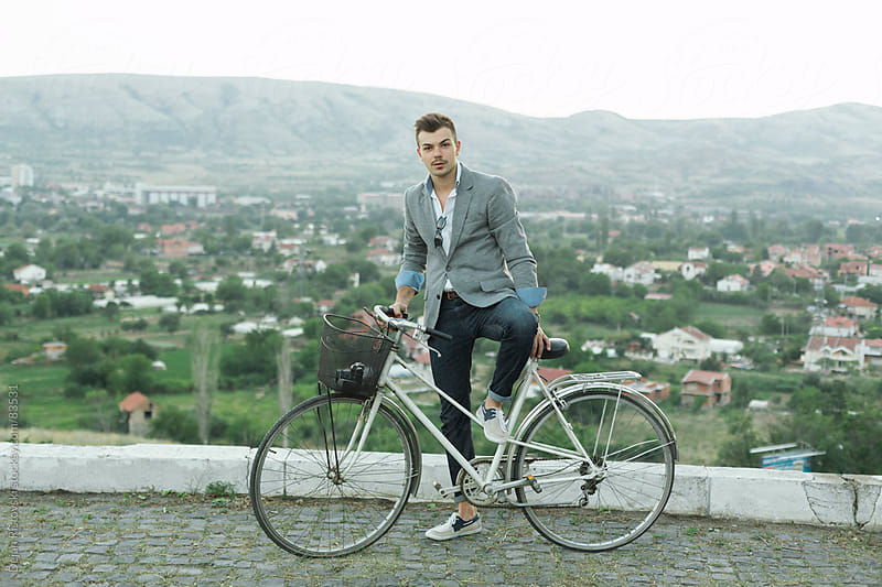 Young man with his bike by Dejan Ristovski for Stocksy United