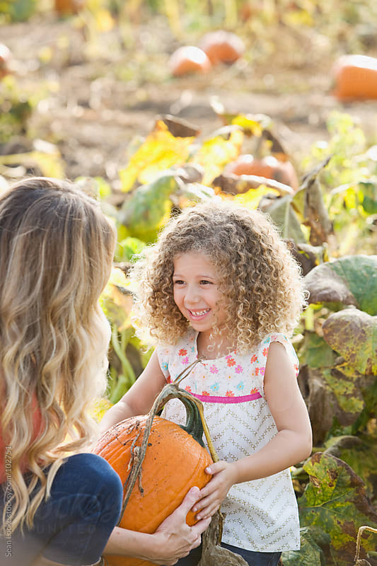Pumpkins: Mother and Child Find Perfect Pumpkin by Sean Locke for Stocksy United