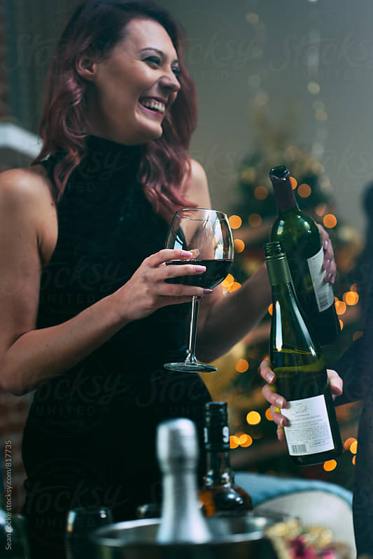NYE: Woman Celebrating Holiday With Glass Of Wine by Sean Locke for Stocksy United