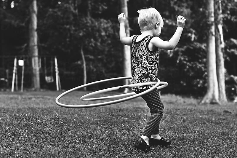 young girl double hula hooping by Jess Lewis for Stocksy United