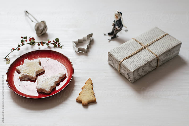 Christmas cookies and present on the white table by Aleksandra Jankovic for Stocksy United