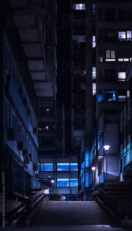 Building in urban environment at night. by Marko Milanovic for Stocksy United