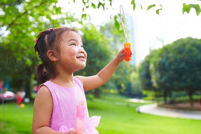 adorable little asian girl outdoor by Bo Bo for Stocksy United