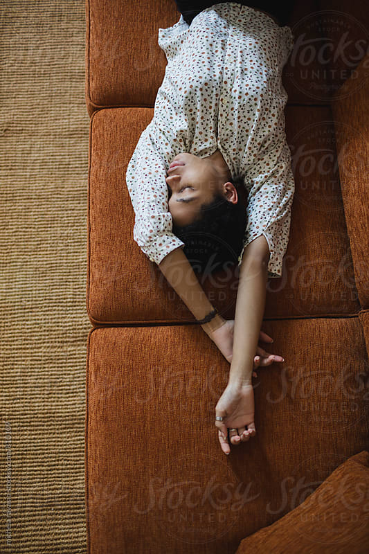 Relaxed woman on the couch by michela ravasio for Stocksy United