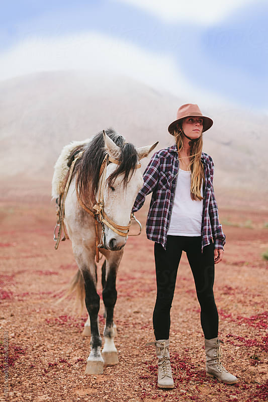 Woman Riding a White Horse in the Middle of a Desert Area by HEX. for Stocksy United