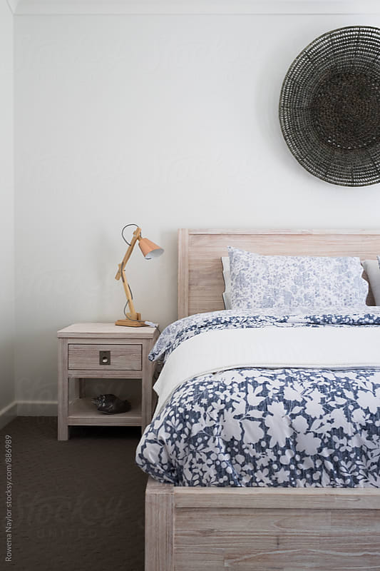 Contemporary bedroom setting by Rowena Naylor for Stocksy United