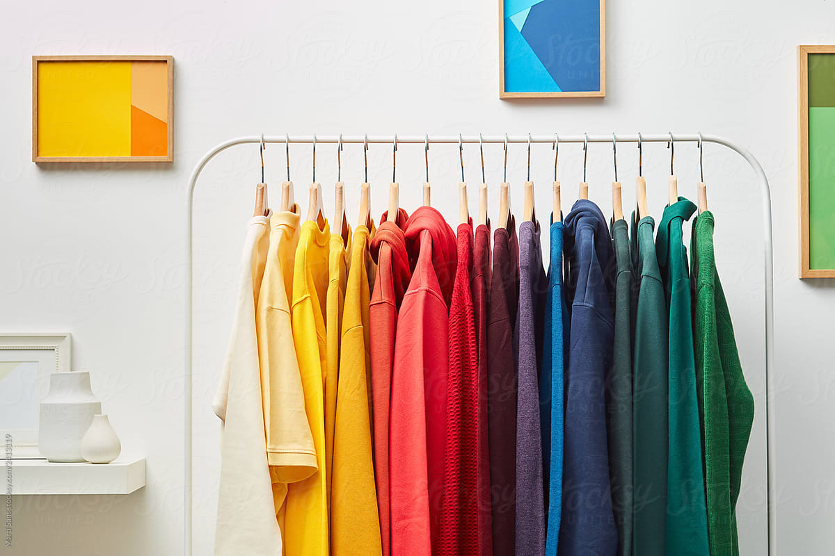 Vibrant clothing on white rack by Martí Sans - Rainbow, Apparel ...