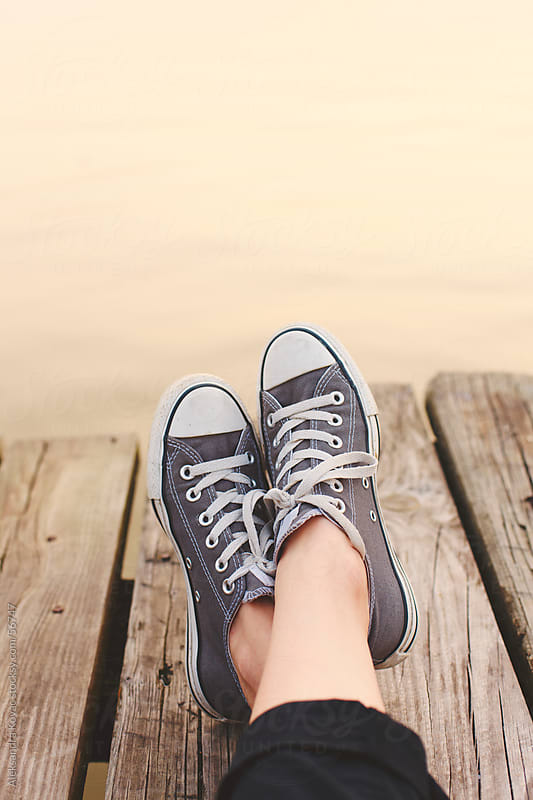 Feet on the dock  by Aleksandra Kovac for Stocksy United