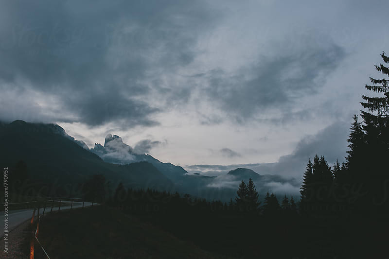 Dramatic morning scene in the austrian alps by Amir Kaljikovic for Stocksy United