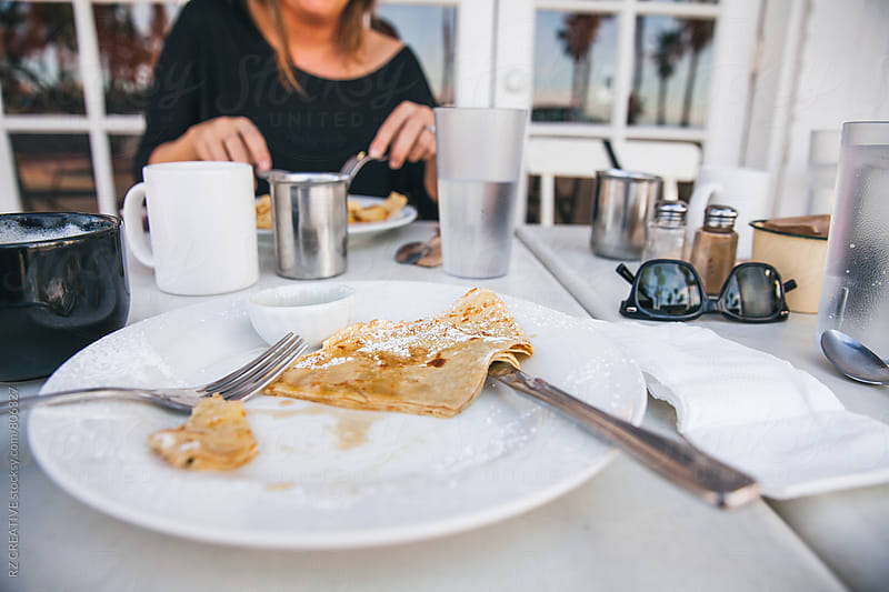 Breakfast crepes and morning coffee. by Robert Zaleski for Stocksy United