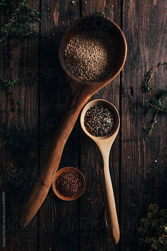 Different kind of seeds in wooden spoons by Nataša Mandić for Stocksy United
