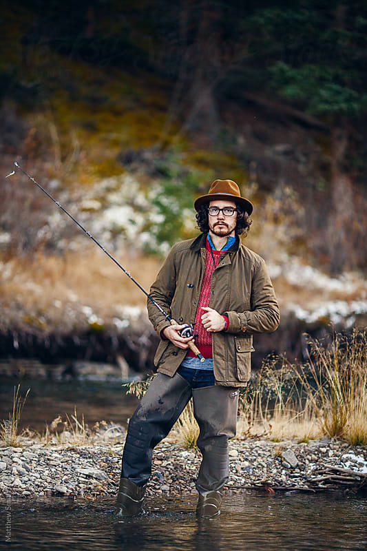 Fly Fisherman Standing In The River by Matthew Smith for Stocksy United