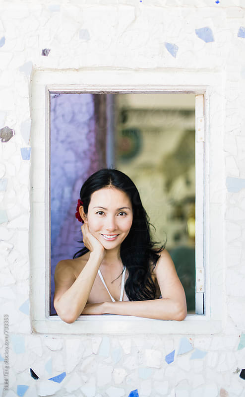 Beautiful Japanese woman portrait by the window by Nabi Tang for Stocksy United