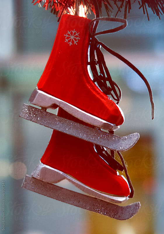 red ice skates christmas decoration by Sonja Lekovic for Stocksy United