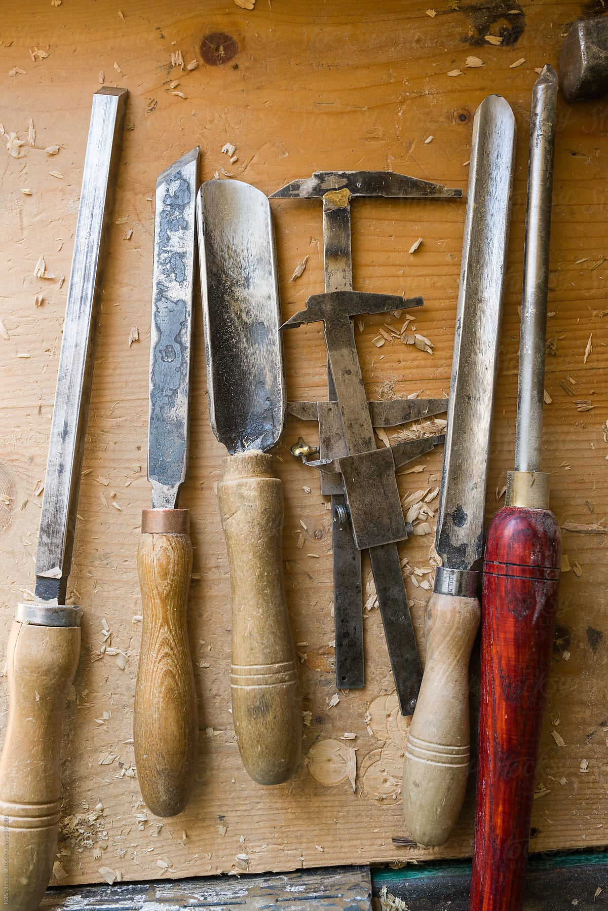 Handicraft Tools Aligned On Wooden Workbench Stocksy United