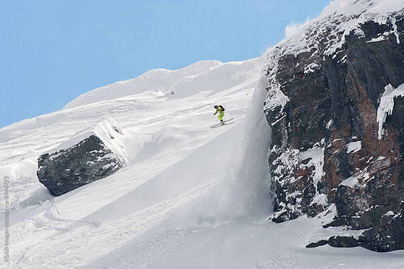 Extreme skier jumping off a snow covered rock by RG&B Images for Stocksy United