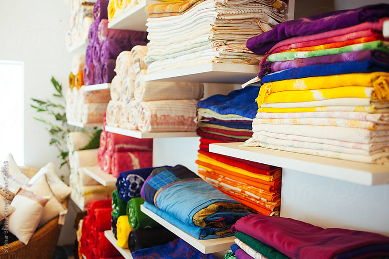 Colorful fabrics at a clothing store. by Shikhar Bhattarai for Stocksy United