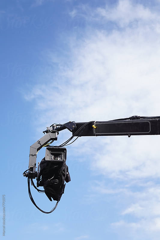 Tv-camera hanging overhead, covered in  a jacket by Marcel for Stocksy United
