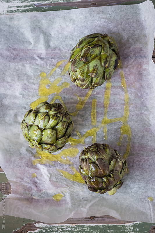 artichokes ready for roasting by Gillian Vann for Stocksy United
