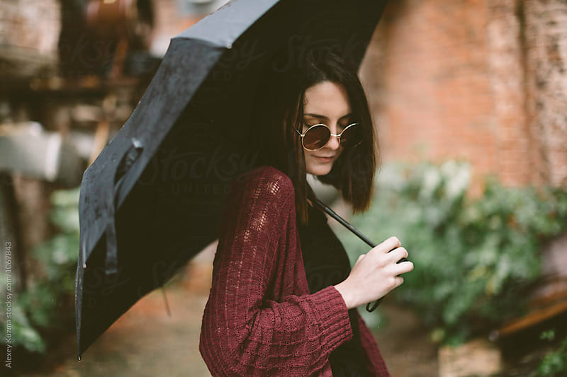portrait of real young woman with umbrella by Vesna for Stocksy United
