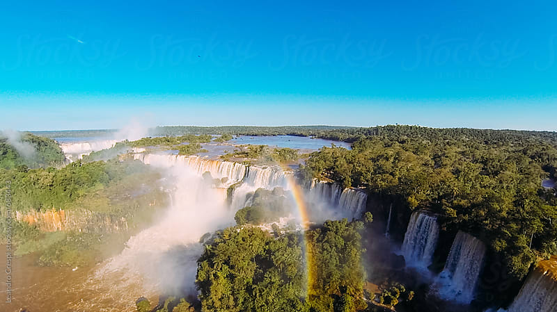 Aerial view of a rainbow over the amazing Iguazu Falls by Leandro Crespi for Stocksy United