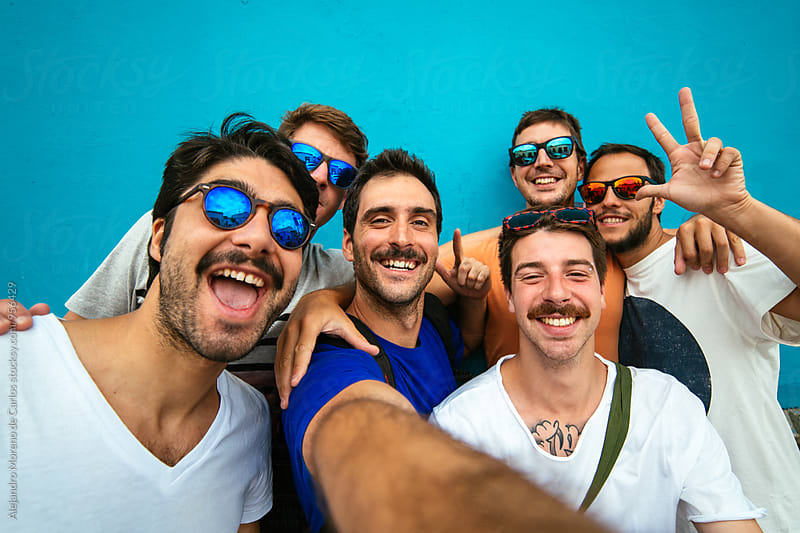 Group of happy friends taking selfie by Alejandro Moreno de Carlos for Stocksy United