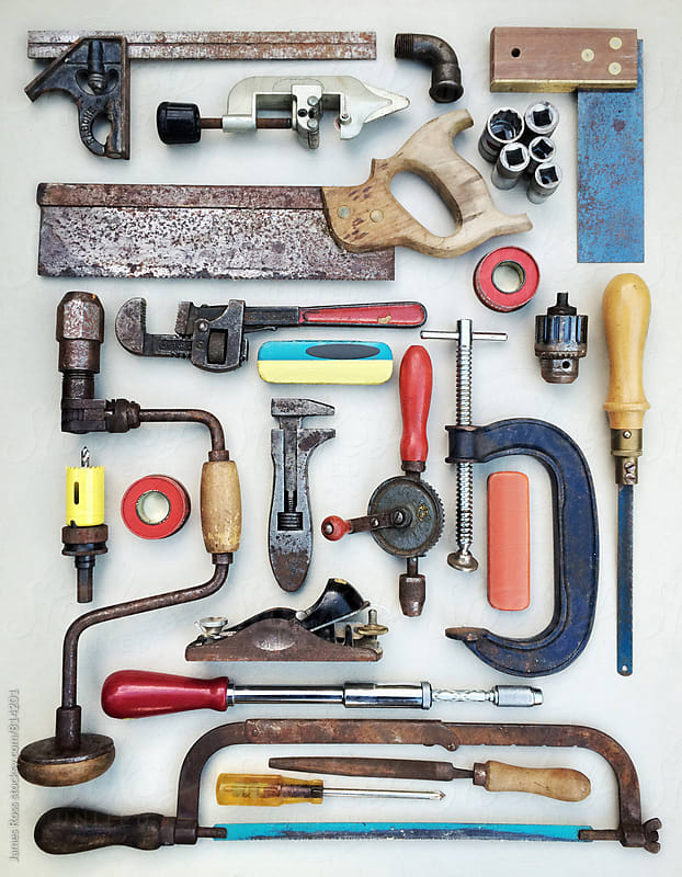 Assorted tools laid out on a work surface by James Ross for Stocksy United