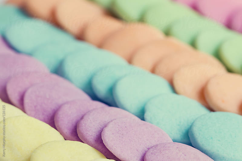 Macro of colorful candy wafers by Kerry Murphy for Stocksy United