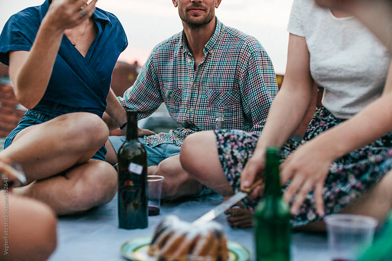 People picnicing on a rooftop by VegterFoto for Stocksy United
